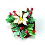 Stella di Natale bianca con agrifoglio