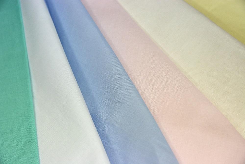 Tessuti per bambini in cotone unito. Millerighe, batista.