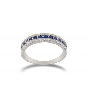 Ring with lateral white and central blue cubic zirconia